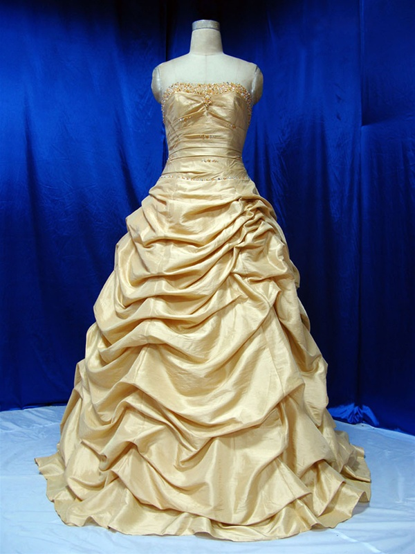 Displayed here is an amazing Gold Taffeta Wedding Dress from one of the top
